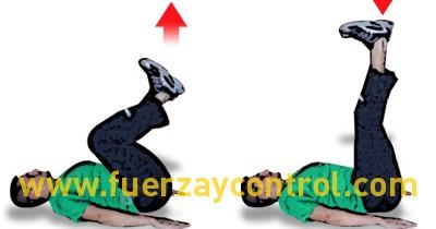 Flexo-extensión de rodillas tumbado boca arriba.